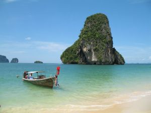 Rock and boat at beach in Thailand